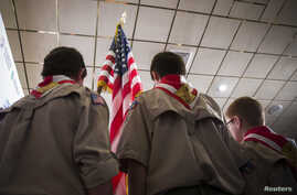 Boy Scouts stand on stage with a U.S. flag during the Pledge of Allegiance to begin the inaugural Freedom Summit meeting for conservative speakers in Manchester, New Hampshire, April 12, 2014.