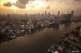The skyline of central Bangkok and the Chao Phraya river are seen during sunrise in Bangkok, Thailand, April 22, 2015.