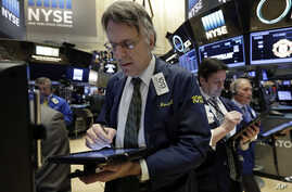 Trader Joseph Chirico works on the floor of the New York Stock Exchange, March 18, 2016.