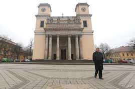 Miklos Beer, the bishop of Vac, walks in front of the cathedral in Vac, Hungary, March 9, 2017.