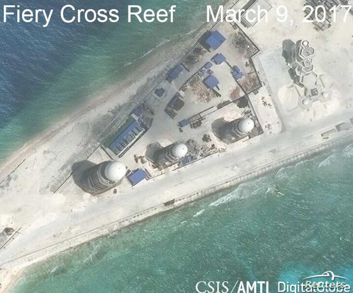 FILE - Construction is shown on Fiery Cross Reef, in the Spratly Islands, the disputed South China Sea in this March 9, 2017, satellite image released by CSIS Asia Maritime Transparency Initiative at the Center for Strategic and International Studies