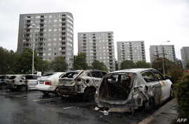 Burned cars are pictured at Froelunda Square in Gothenburg, Sweden on Aug. 14, 2018.