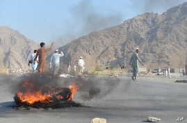 Men shout slogans against terrorists after a suicide attack among the protesters in Momandara district of Nangarhar province, Afghanistan, Sept. 11, 2018.