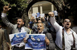 Dozens of lawyers shout slogans during a protest against the accord to hand over control of two strategic Red Sea islands, Tiran and Sanafir, to Saudi Arabia in front of the lawyers syndicate in Cairo, Egypt, June 13, 2017.