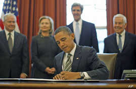 US President Barack Obama signs the new Strategic Arms Reduction Treaty [START] in the Oval Office of the White House in Washington, February 2, 2011.
