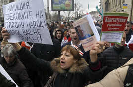 People shout slogans at a rally in Minsk, Belarus, March 15, 2017. The banner on the left calls on police to join the demonstrators.