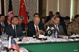 In this handout photograph released by the Associated Press of Pakistan (APP) on February 6, 2016, Pakistan's National Security Advisor Sartaj Aziz (C) chairs the third round of four-way peace talks  with Afghanistan, US and Chinese delegates in Isla