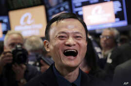 FILE - Jack Ma, founder of Alibaba, smiles during the company's IPO at the New York Stock Exchange in New York, Friday, Sept. 19, 2014..