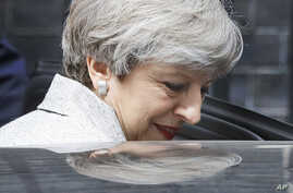 Britain's Prime Minister Theresa May leaves after a meeting with the Leader of Northern Ireland's Democratic Unionist Party (DUP) Arlene Foster at 10 Downing Street after the general election in London, June 13, 2017.