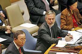Antonio de Aguiar Patriota, center, Foreign Minister of Brazil looks at Secretary General Ban Ki-moon, left, at a Security Council meeting to discuss maintenance of International Peace and Security at United Nations Headquarters in New York, February