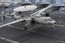 An E-2C Hawkeye from the Liberty Bells of Airborne Early Warning Squadron (VAW) 115 prepares to land on the flight deck of the aircraft carrier USS George Washington, Sept. 20, 2014.