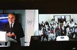This composite view during a live video conference on March 14, 2011, shows International Criminal Court Prosecutor Luis Moreno Ocampo, left, as he speaks from The Hague, Netherlands, with a group of Kenyan journalists in Nairobi, Kenya