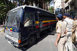 A police van transports some of those convicted in connection with a series of blasts in 1993, outside a court in Mumbai, India, June 16, 2017.