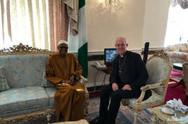 Archbishop of Canterbury, Justin Welby sits with Nigeria's President Muhammadu Buhari in Abuja House, London, March 9, 2017.