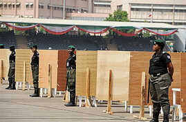 Police women stand in front of voting centres ahead of the presidential primaries of the ruling People Democratic Party in Abuja, 13 Jan 2011