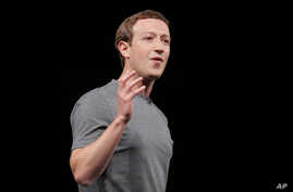 Facebook CEO Mark Zuckerberg gestures during the Samsung Galaxy Unpacked 2016 event on the eve of this week's Mobile World Congress wireless show, in Barcelona, Spain, Feb. 21, 2016.