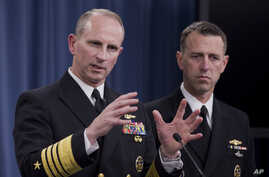 Chief of Naval Operations, Admiral Jonathan W. Greenert (L), accompanied by Admiral John M. Richardson, director of the Naval Nuclear Propulsion Program, speaks during a news conference at the Pentagon, Feb. 4, 2014.