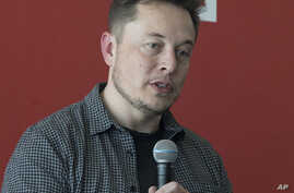 FILE - Tesla Motors Inc., CEO Elon Musk discusses the company's new Gigafactory in Sparks, Nevada, July 26, 2016.