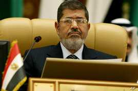 FILE - Egyptian President Mohammed Morsi attends the third session of the Arab Economic Summit, in Riyadh, Saudi Arabia, Monday, Jan. 21, 2013.