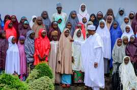Nigeria's President Muhammadu Buhari meets with some of the newly released Dapchi schoolgirls