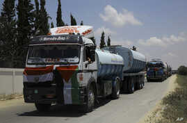 Egyptian trucks carrying fuel enter Gaza's power plant in Nusseirat, in the central Gaza Strip, June 21, 2017.