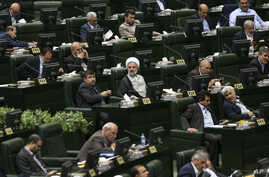 Iranian lawmakers attend an open session of parliament to choose the interim presiding board in Tehran, Iran, Sunday, May 29, 2016. Iran's long-serving parliament speaker Ali Larijani will retain his post despite gains by reformists in elections held