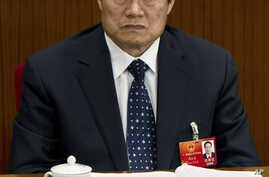 FILE - In this March 11, 2012 file photo, Zhou Yongkang, then Chinese Communist Party Politburo Standing Committee member in charge of security, attends a plenary session of the National People's Congress at the Great Hall of the People in Beijing, C