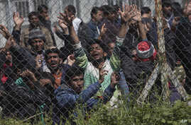 Migrants, most of them from Pakistan, protest against the EU- Turkey deal about migration inside the entrance of Moria camp in the Greek island of Lesbos on Tuesday, April 5, 2016.