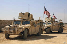 U.S. forces take up positions on the outskirts of the Syrian town, Manbij, a flashpoint between Turkish troops and allied Syrian fighters and U.S.-backed Kurdish fighters, March 7, 2017.