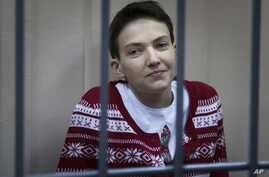 Ukrainian jailed military officer Nadezhda Savchenko sits in a cage at a court room in Moscow, Russia, March 4, 2015.