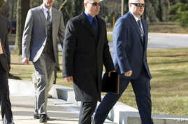 Officer Edward Nero, from left, Lt. Brian Rice and Officer Garrett Miller three of six Baltimore city police officers charged in connection to the death of Freddie Gray, arrive to Maryland Court of Appeals on March 3, 2016, in Annapolis, Md.