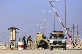 In this Nov.13, 2018, a military ambulance crossing from the Syrian side of the border to Iraq in Qaim, Anbar province, Iraq.