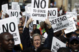 Demonstrators protest against South African President Jacob Zuma in Pretoria, South Africa, April 7, 2017. South Africans are gathering for nationwide demonstrations against Zuma, whose dismissal of the finance minister fueled concerns over governmen
