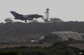 A warplane comes in to land after completing a mission at Britain's Royal Air Force Base in Akrotiri near the southern city of Limassol, Cyprus, Sept. 27, 2014.