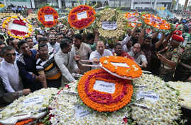 Local residents pay their respects to the victims of the attack at the Holey Artisan Bakery at a stadium in Dhaka, Bangladesh, July 4, 2016.
