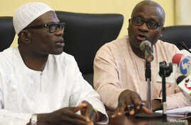 Lateef Aderemi Ibirogba, Lagos' State Commissioner for Information and Strategy (L), sits with Dr. Jide Idris, the Commissioner for Health, during a news conference on the death of an Ebola victim in Lagos, July 25, 2014.