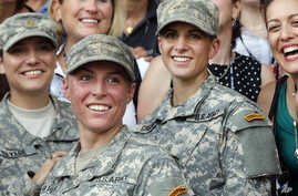 U.S. Army 1st Lt. Shaye Haver, center, and Capt. Kristen Griest, right, pose for photos with other female West Point alumni after an Army Ranger school graduation ceremony at Fort Benning, Ga., Aug. 21, 2015.