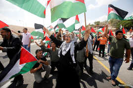 Palestinians take part in a protest against the planned Israeli demolition of the Bedouin village of Khan al-Ahmar, in the occupied West Bank, Sept. 7, 2018.