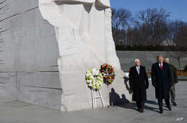 President Donald Trump and Vice President Mike Pence visit the Martin Luther King Jr. Memorial, in Washington, Jan. 21, 2019.
