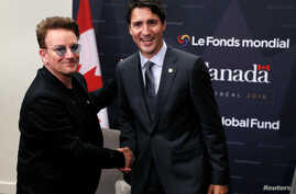 Canada's Prime Minister Justin Trudeau and singer Bono shake hands during a bilateral meeting during the Fifth Replenishment Conference of the Global Fund to Fight AIDS, Tuberculosis and Malaria in Montreal, Quebec, Sept. 17, 2016.