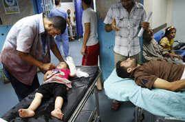 Patients are treated in Shifa hospital in Gaza City, July 18, 2014.