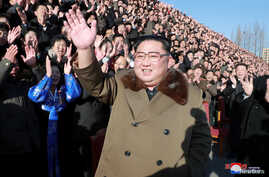 North Korean leader Kim Jong Un meets with participants in the 4th National Meeting of Activists in Agricultural Field in Pyongyang, North Korea, in this undated picture released by North Korea's Korean Central News Agency, Dec. 28, 2018.