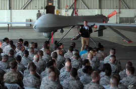 FILE - U.S. Defense Secretary Ash Carter addresses the U.S. troops as he stands in front of a drone at the Incirlik Air Base near Adana, Turkey, Dec. 15, 2015.