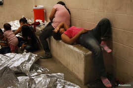 Immigrants who have been caught crossing the border illegally are housed inside the McAllen Border Patrol Station in McAllen,Texas, July 15, 2014, where they are processed.