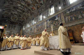 Newly elected Pope Francis I, Cardinal Jorge Mario Bergoglio of Argentina, leads a a mass with cardinals at the Sistine Chapel, in a picture released by Osservatore Romano at the Vatican, March 14, 2013.