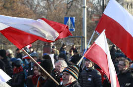 FILE - Supporters of the  Committee for the Defense of Democracy movement  stage  a protest against the government  in Warsaw, Jan. 23, 2016.