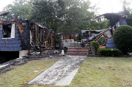 The house owned by Lawrence Police Officer Ivan Soto sits nearly burned to the ground on Jefferson Street, in Lawrence, Mass., Sept. 14, 2018. It was one of multiple houses that went up in flames Thursday afternoon after gas explosions and fires trig