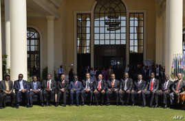 Representatives of the Southern African Development Community (SADC) pose for a family photo during the 35th SADC ordinary summit of head of state and government in Gaborone, Aug. 17, 2015.