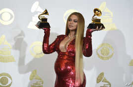 "Beyonce poses in the press room with the awards for best music video for ""Formation"" and best urban contemporary album for ""Lemonade"" at the 59th annual Grammy Awards at the Staples Center, Feb. 12, 2017, in Los Angeles."