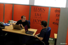 Young entrepreneurs discuss in their office, in a building offered by Eurobank's startup accelerator programme EGG in Athens, Greece, February 22, 2018.